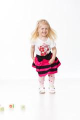 Funny girl standing on white
