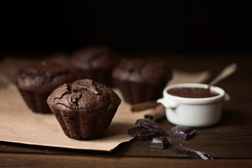 Chocolate muffins on the table, dark background