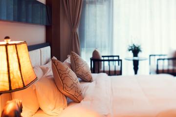 Night scene in hotel room: prepared fresh bed