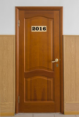 Closed wooden office door with Number 2016.