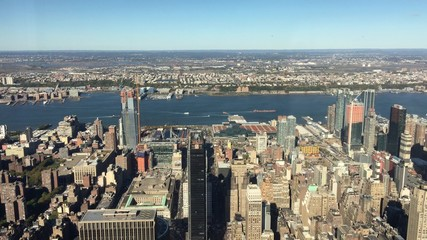Fototapete - New York City. 4K aerial view of skyscrapers on a beautiful sunny day