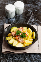 Salmon with zucchini decorated parsley in cast-iron pan