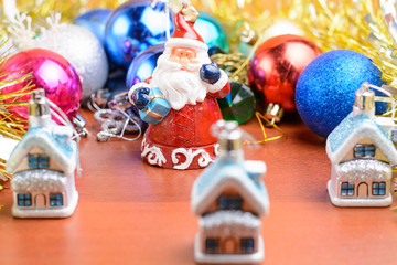 Christmas tinsel and toys on a wooden background