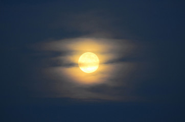 full moon with veil of clouds