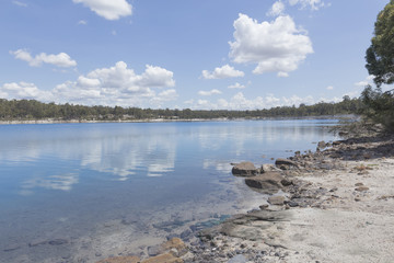 Stockton Lake near Collie surrounded by Natural Bush under White Clouds and Blue Sky on a Sunny Day