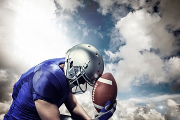 Composite image of upset american football player with ball