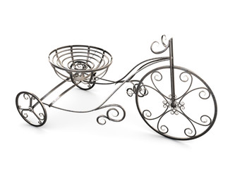 Small metal decorative tricycle.