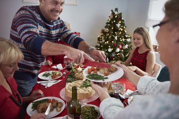 Celebrating christmas eve with family
