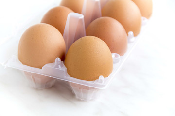 Brown chicken eggs in plastic packaging