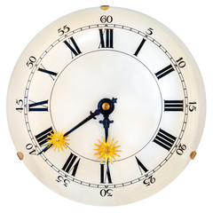 Ancient clock face with small golden sun clock hands