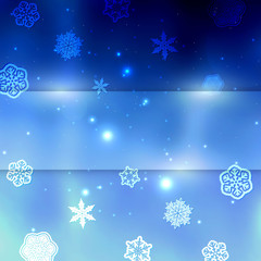New year blue blurred background with snowflakes