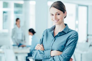 Smiling female office worker portrait
