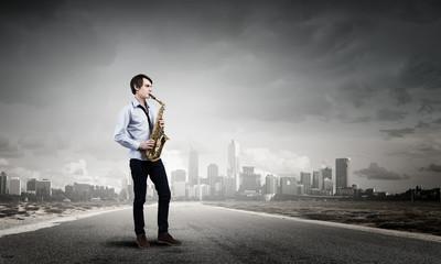 Handsome saxophonist. Concept image