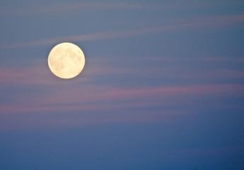 Brilliant full moon on pink and blue sky, Stockholm, Sweden in October.