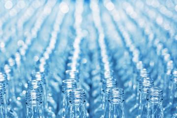 Number empty glass bottles on conveyor