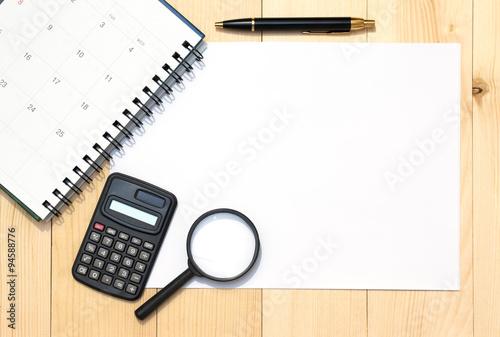 Top View On White Paper Calculator Calendar Pen