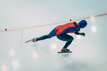 girl speed skaters goes on ice. view from top. no face