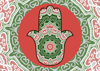 Card with a pattern in ethnic style - red and green hamsa with mandala on background