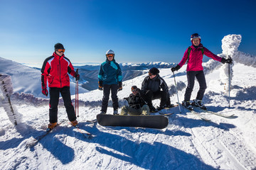 Happy friends having fun in Mountains ski resort - nature and sport picture