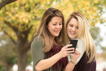 Women looking at their moblie phone.