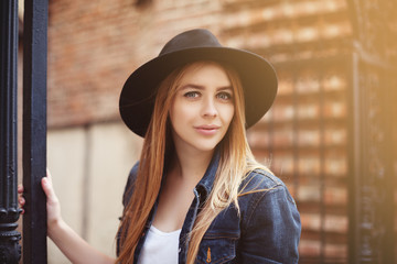 Portrait of beautiful girl wearinf hat looking at camera. Close up. Toned