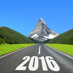 Asphalted road in mountain landscape. Forward to the New Year 2016