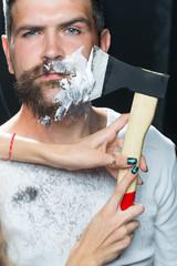 Bearded man having shaved