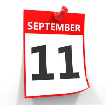 11 september calendar sheet with red pin.