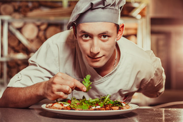 Wall Mural - male cook preparing delicious appetizer