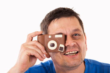 A man photographed with a camera made of chocolate - isolated