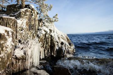 Frozen lakefront rock cliff