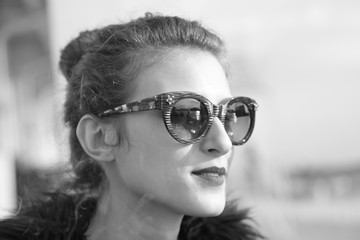 Urban girl with sunglasses posing black and white photography