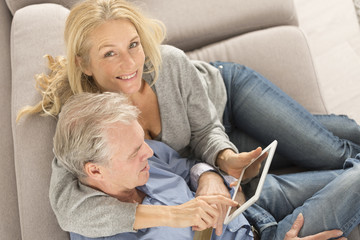 a middle-aged couple buys on-line