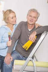 Mature couple decorating house