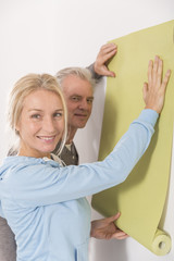 Mature couple decorating house