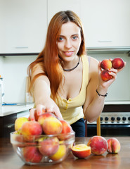 cheerful houswife taking peaches