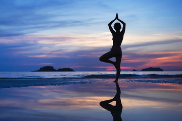 yoga background, beautiful silhouette of the woman