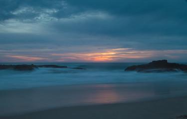 Long exposure of rocks in waves, giving a mist like effect over ocean in Laguna Beach, California