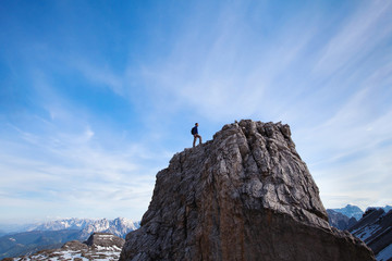 achievment concept, climber on top of the mountain