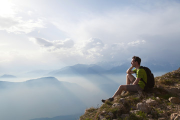 traveler enjoying panoramic view during hike, beautiful background with mountain landscape