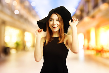 Happy young woman in a black