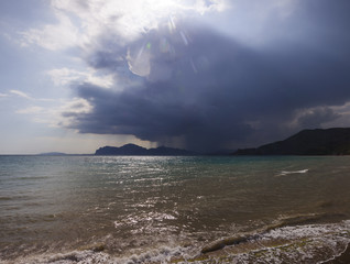 rain cloud over the sea harbour