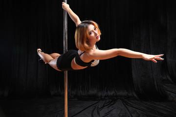 Beautiful Asian woman pole dance