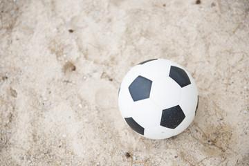football on sand beach