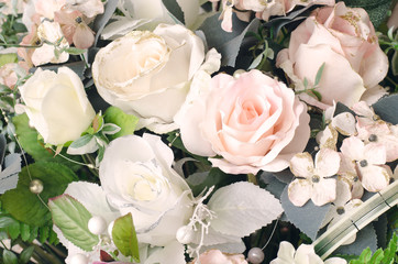 Artificial orange and white rose flowers bouquet