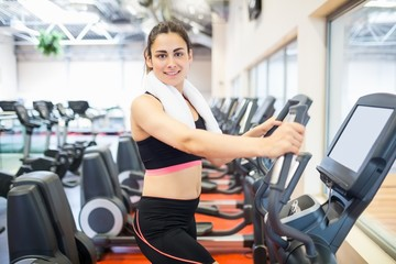 Focused woman on the cross trainer