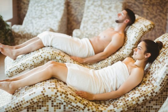 Man and woman lying down together