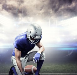 Composite image of american football player kneeling