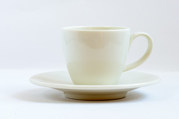White coffee cup on a white background