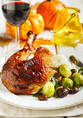 Roasted turkey leg garnished with mash potato, chestnuts and brussels sprouts